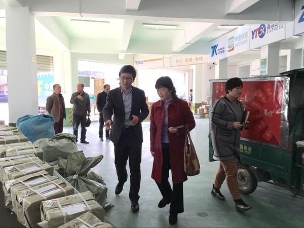 县政协对全县乡村邮政网点建设情况开展视察.jpg